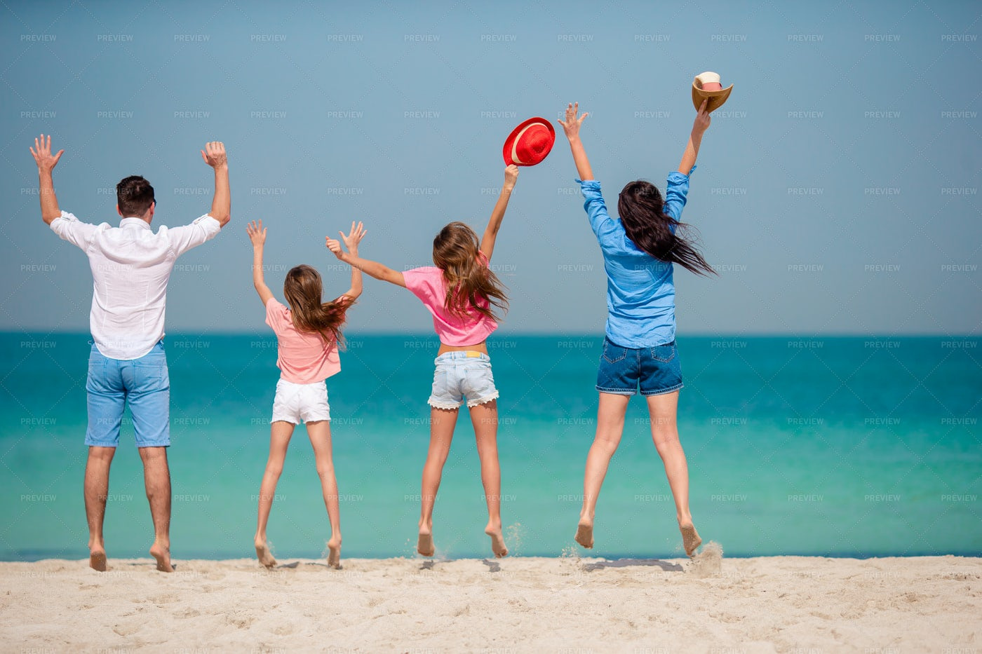 Happy Family On The Beach: Stock Photos