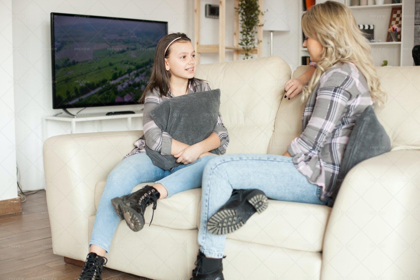 On The Couch Clutching Pillows: Stock Photos