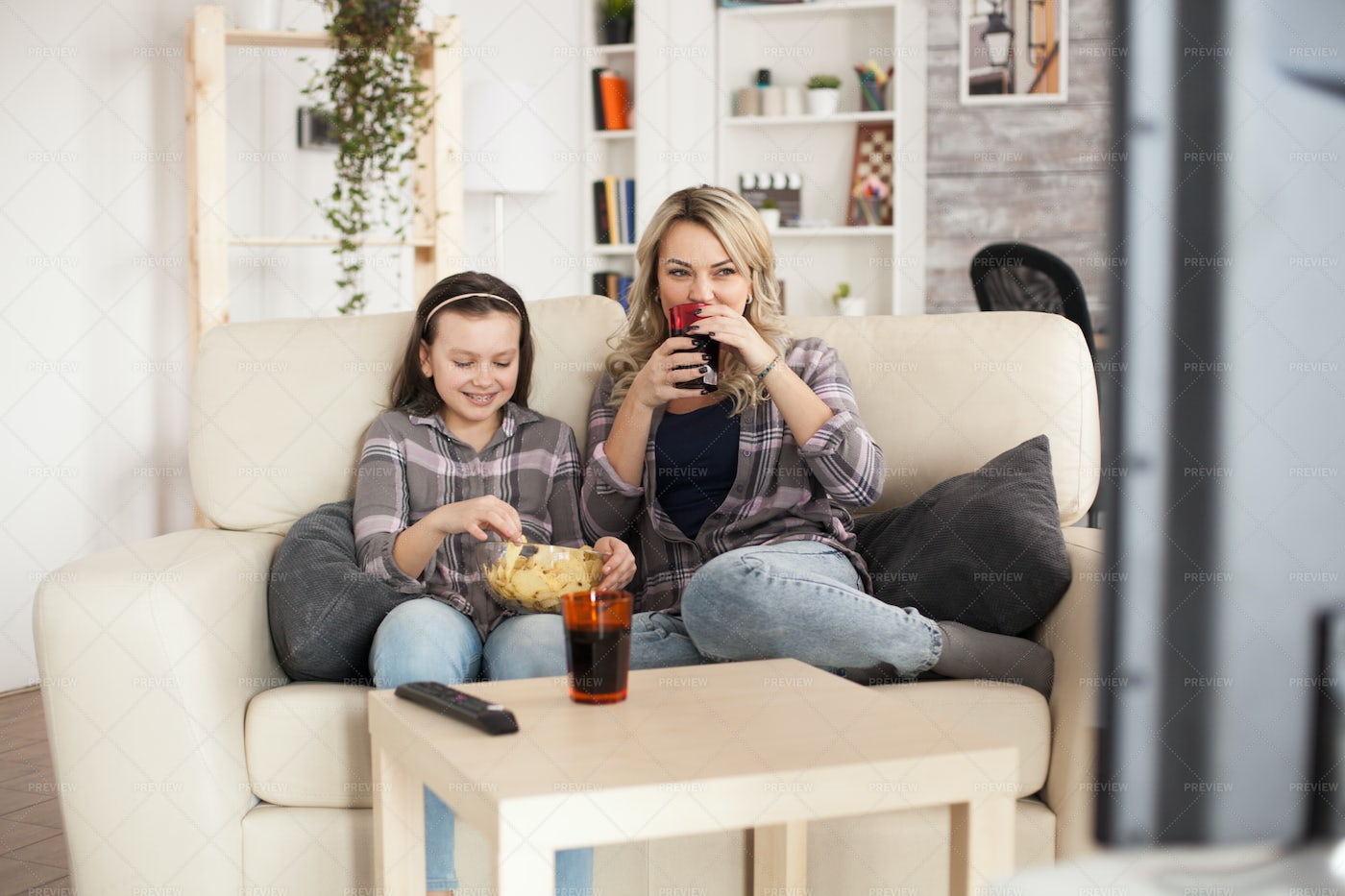 Mother And Daughter In Living Room: Stock Photos