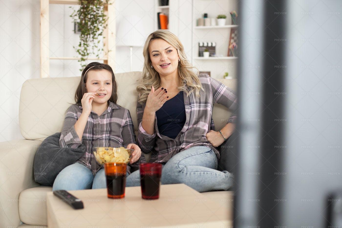 Mother And Daughter Watching TV: Stock Photos