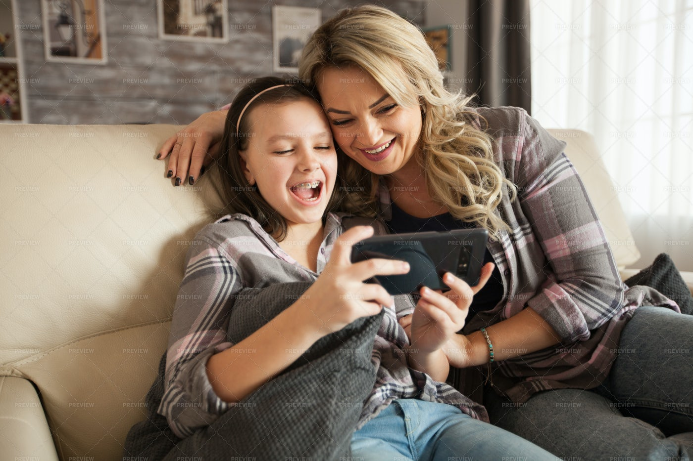 Playing With A Phone Together: Stock Photos