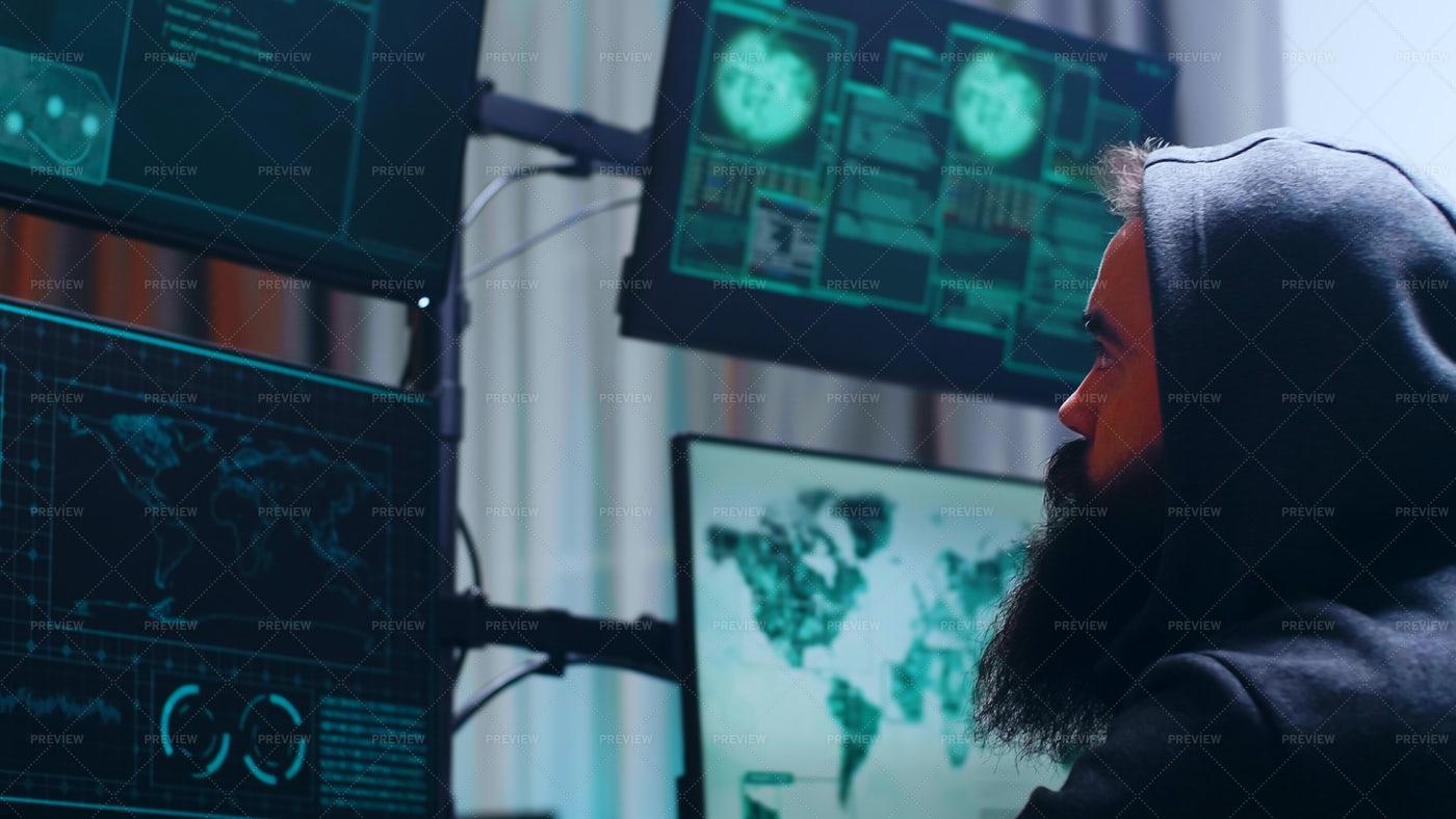 Hacker Watches The Monitors: Stock Photos