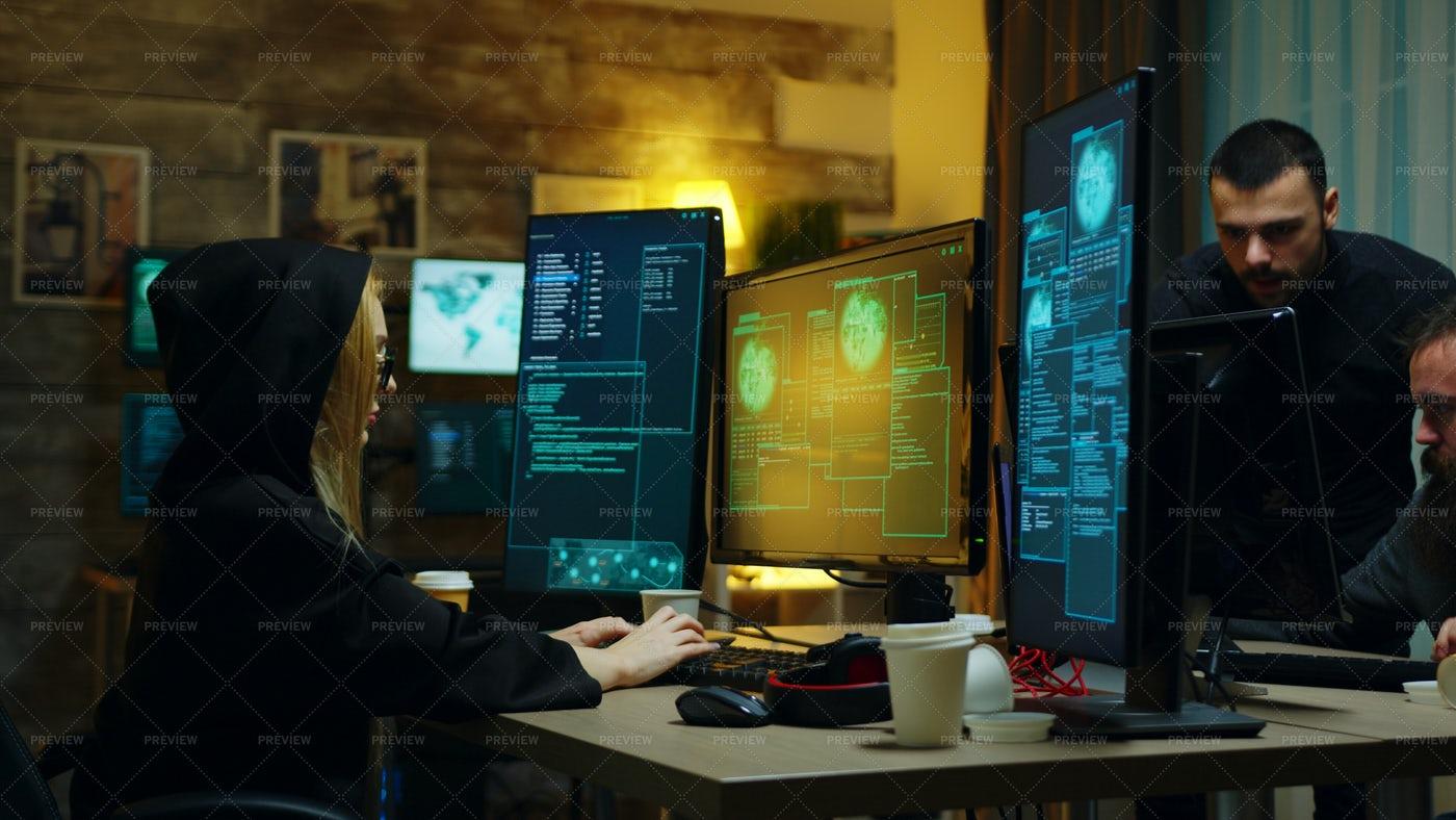 Hacker Typing A Virus: Stock Photos