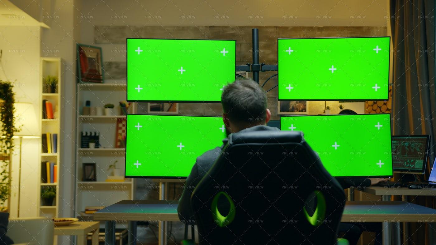 Man Using Multiple Screens: Stock Photos