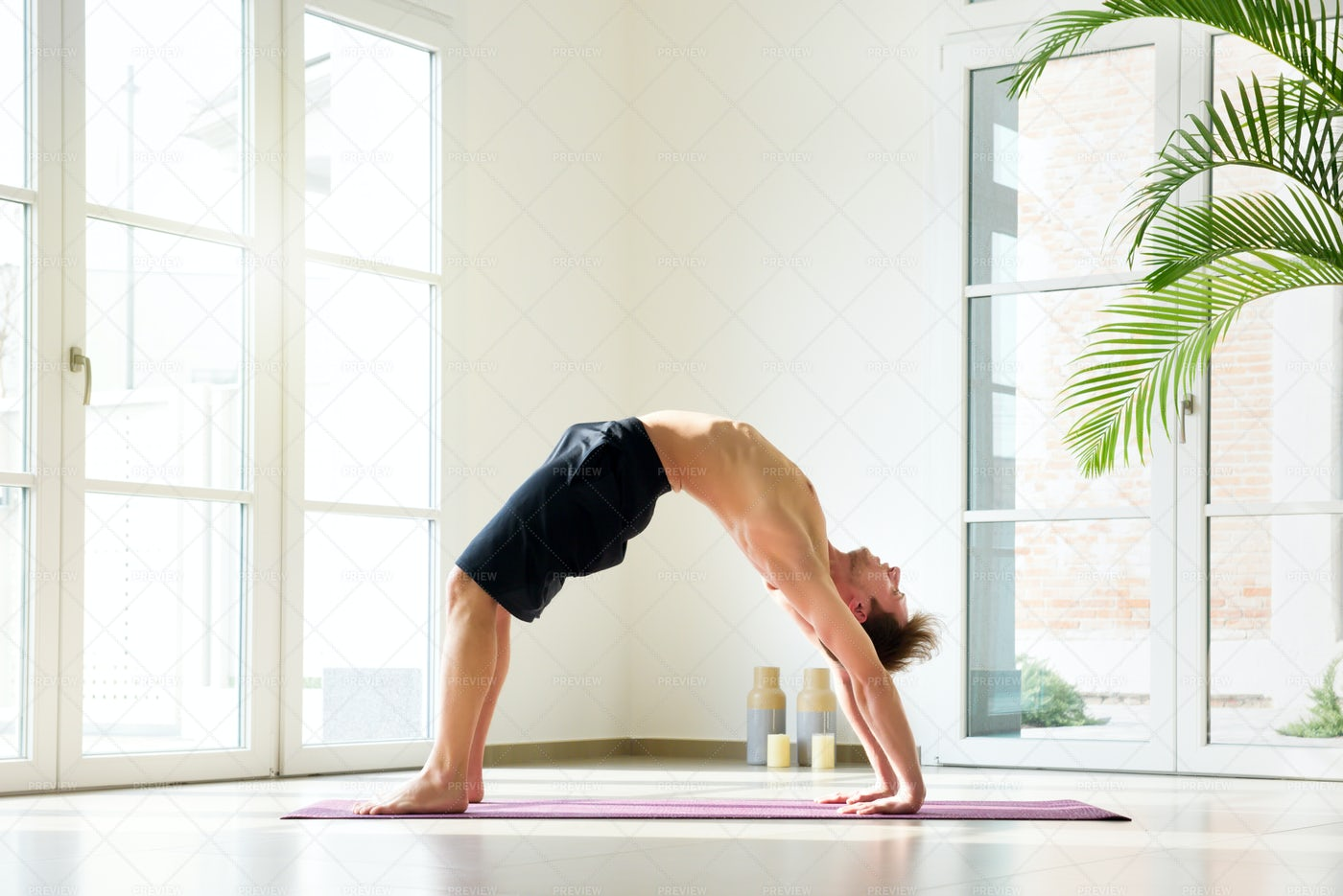 Man Practicing Yoga At Home: Stock Photos