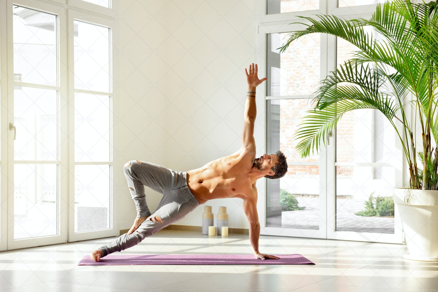 Peforming A Side Plank: Stock Photos