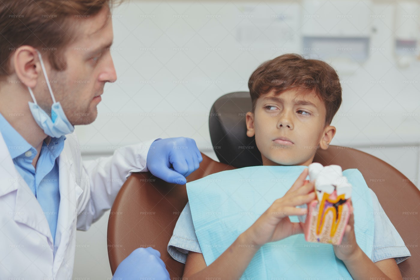 Worried Boy At The Dentist: Stock Photos