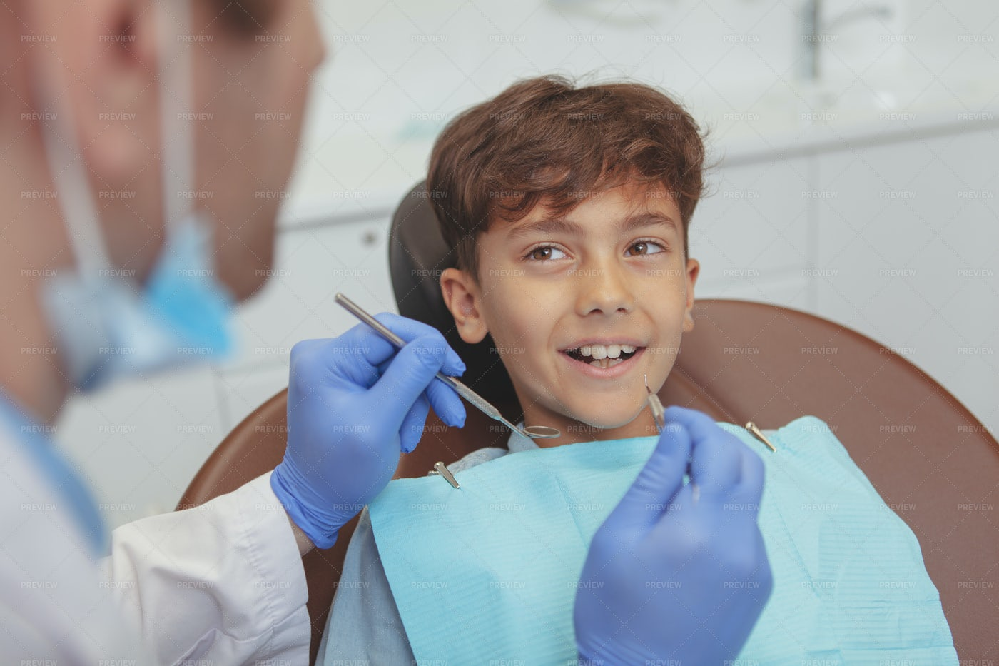 Kid Receives Dental Check-Up: Stock Photos