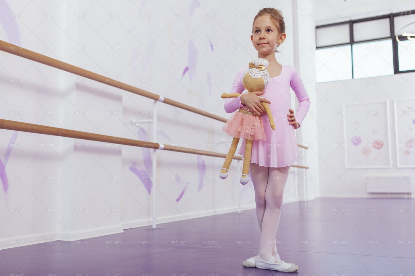 Ballerina Standing With Toy: Stock Photos