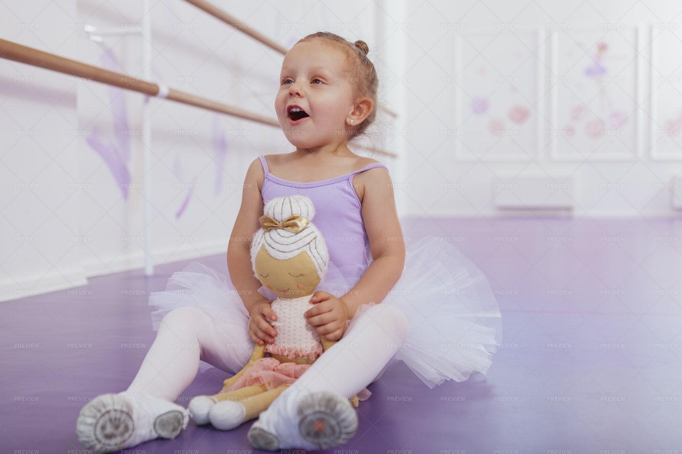 Ballerina With A Doll: Stock Photos