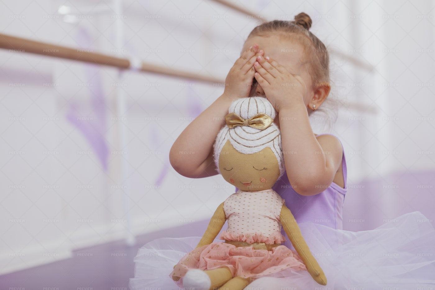 Ballerina With Toy Doll: Stock Photos
