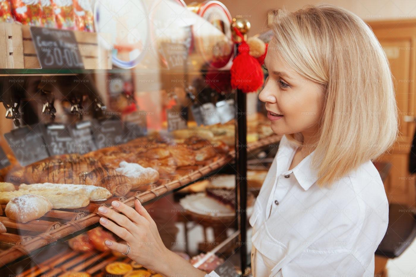 Woman Shopping In A Bakery: Stock Photos