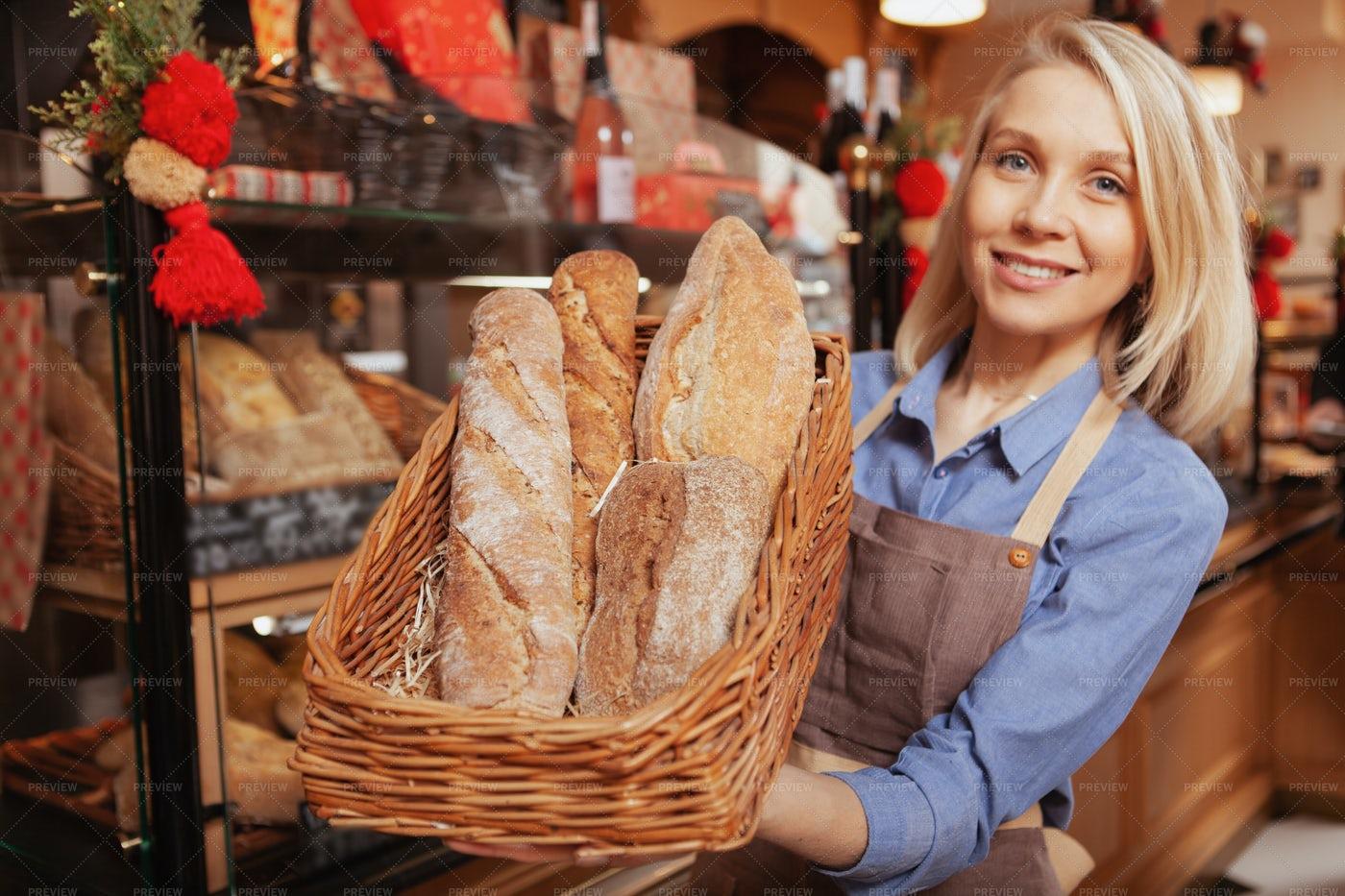 Baker Presenting Bread: Stock Photos