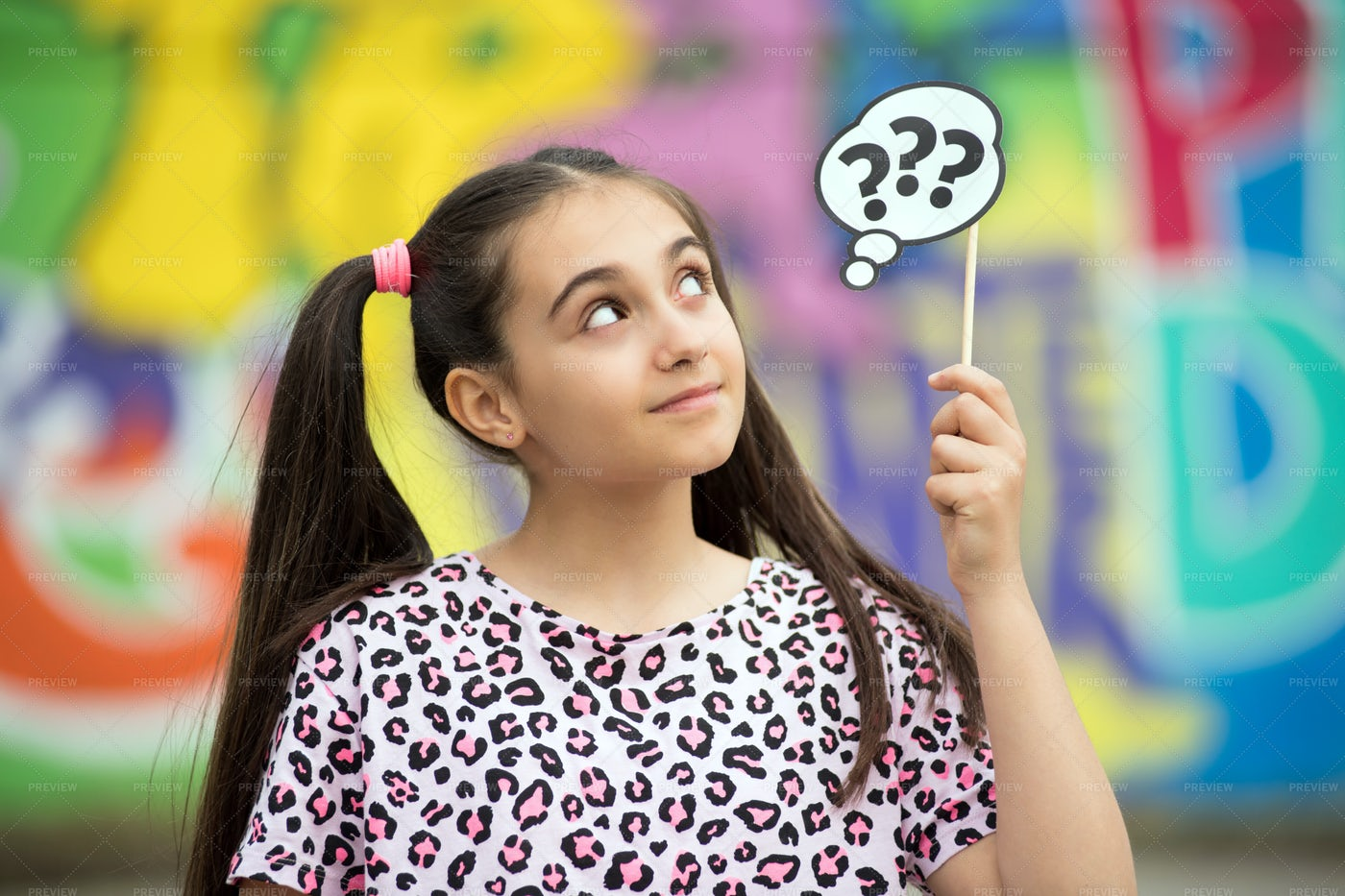 Girl Holding Up Question Mark: Stock Photos