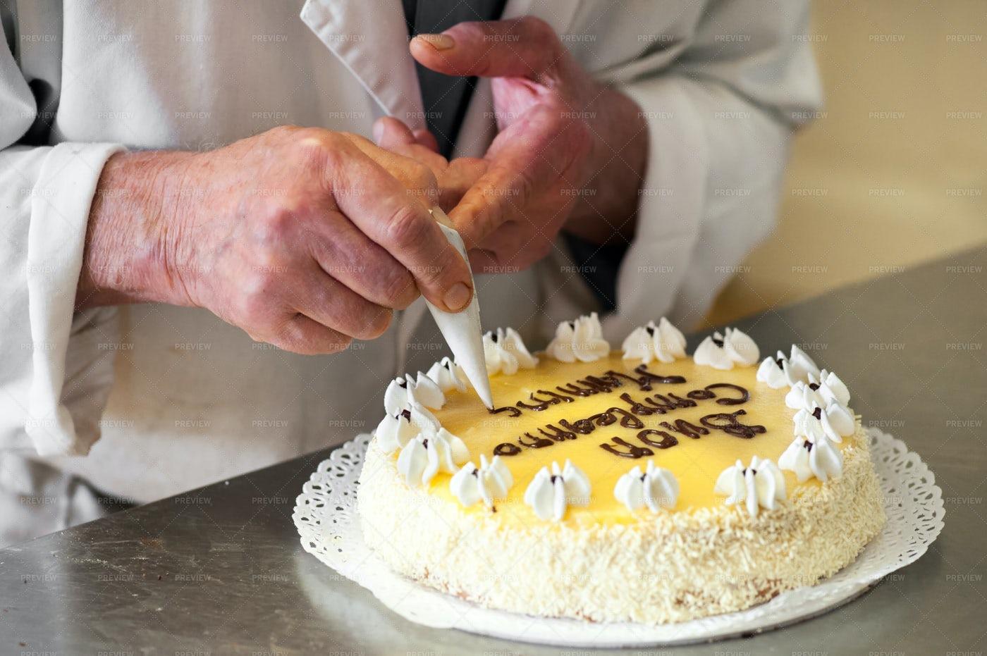 Baker Writing Birthday Message: Stock Photos