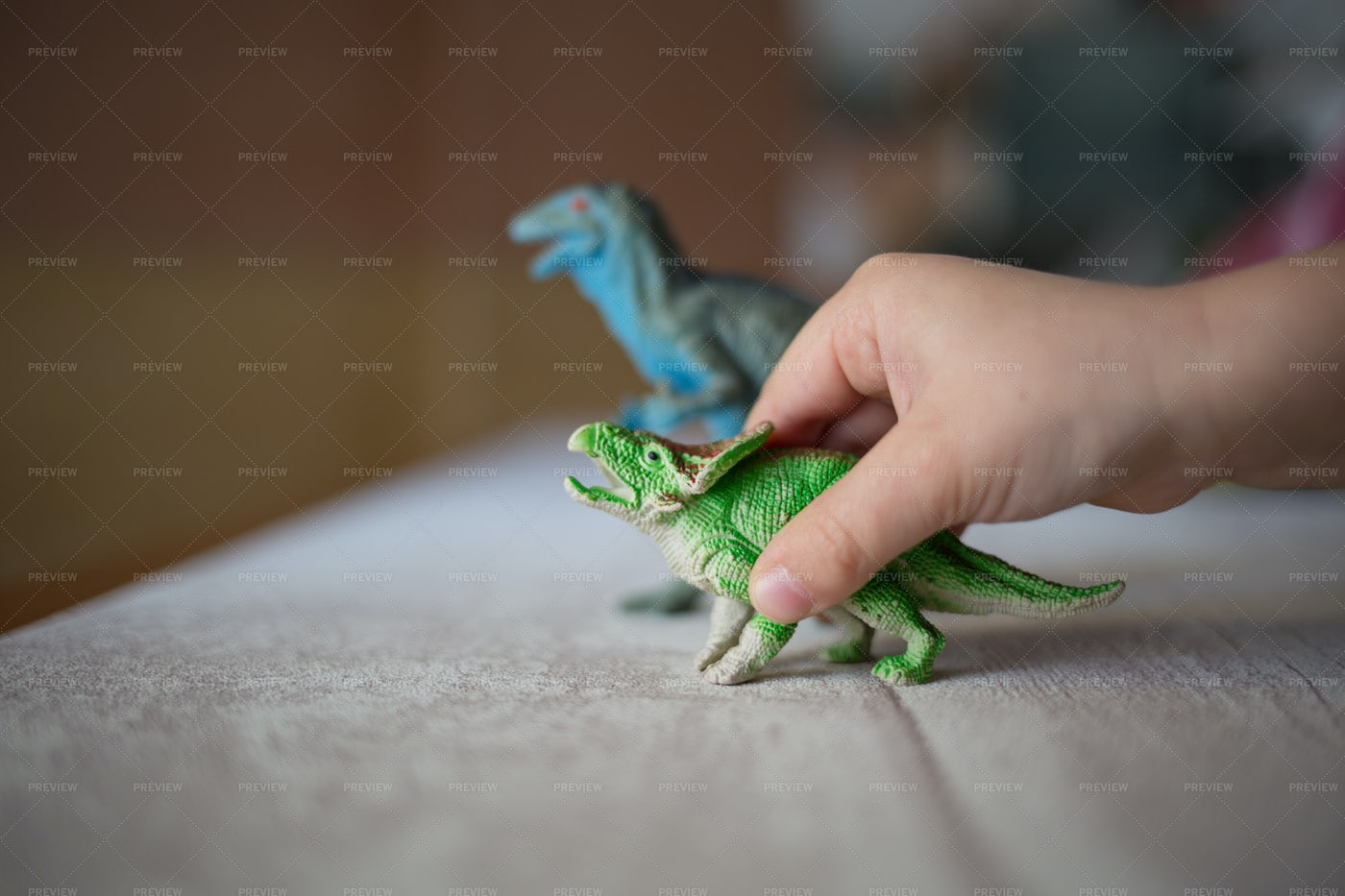 Child Playing With Dinosaurs: Stock Photos