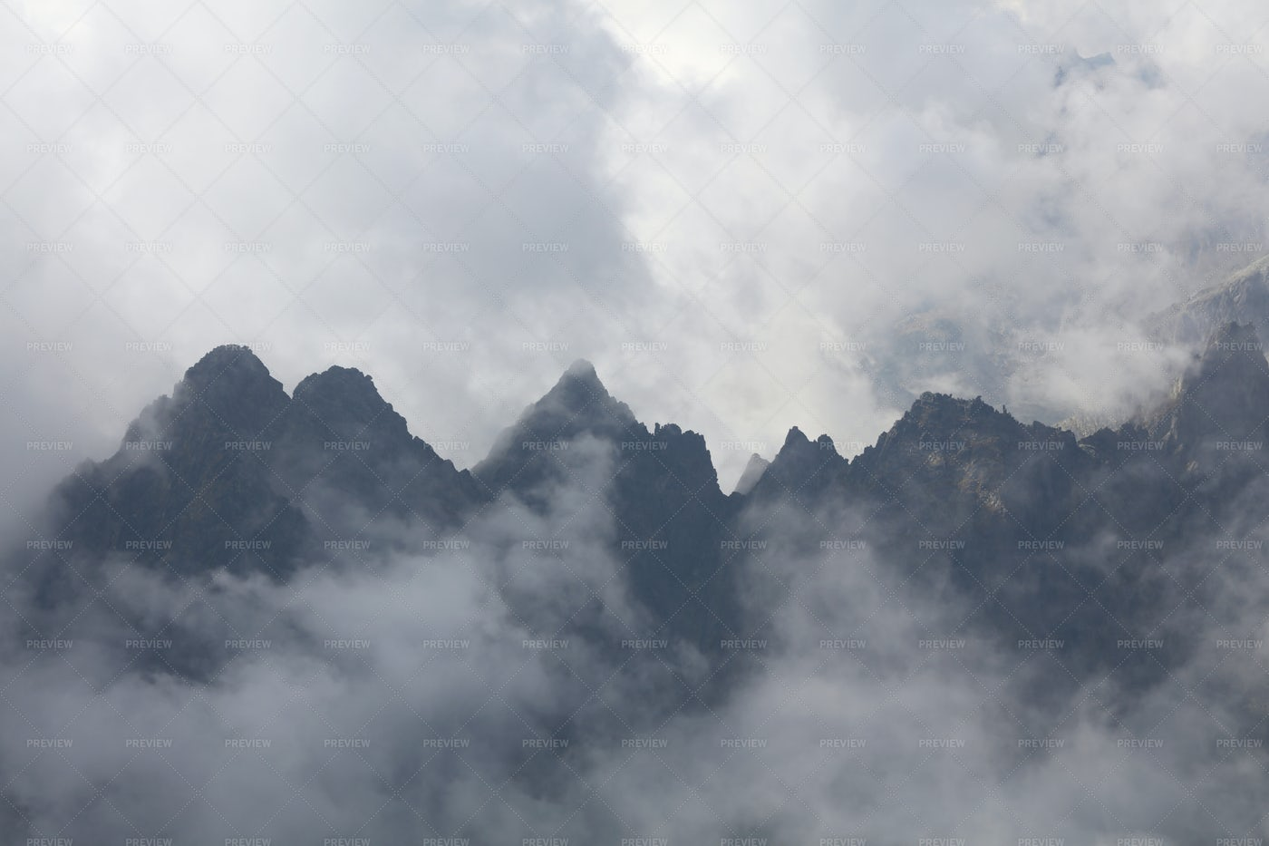 Mountains And Foggy Clouds: Stock Photos