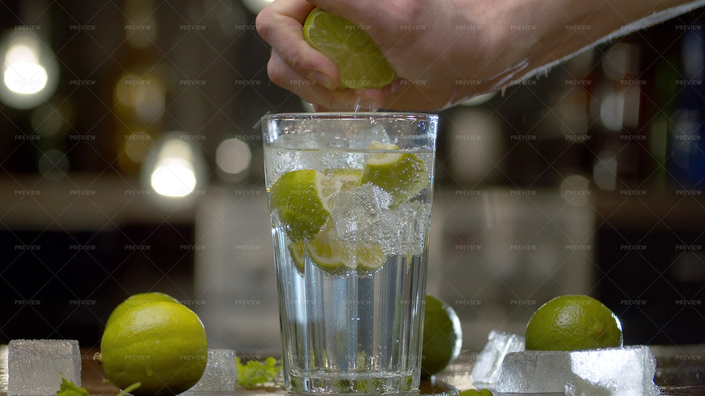 Squeezing Lime Into Beverage: Stock Photos