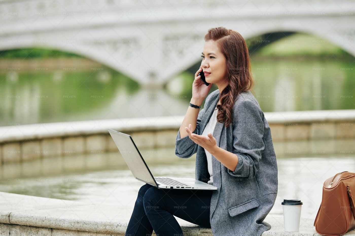 Frowning Businesswoman Calling On Phone: Stock Photos