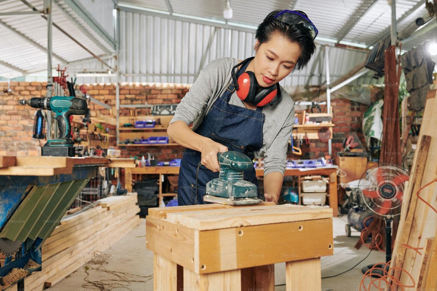Carpenter Polishing Wooden Surface: Stock Photos