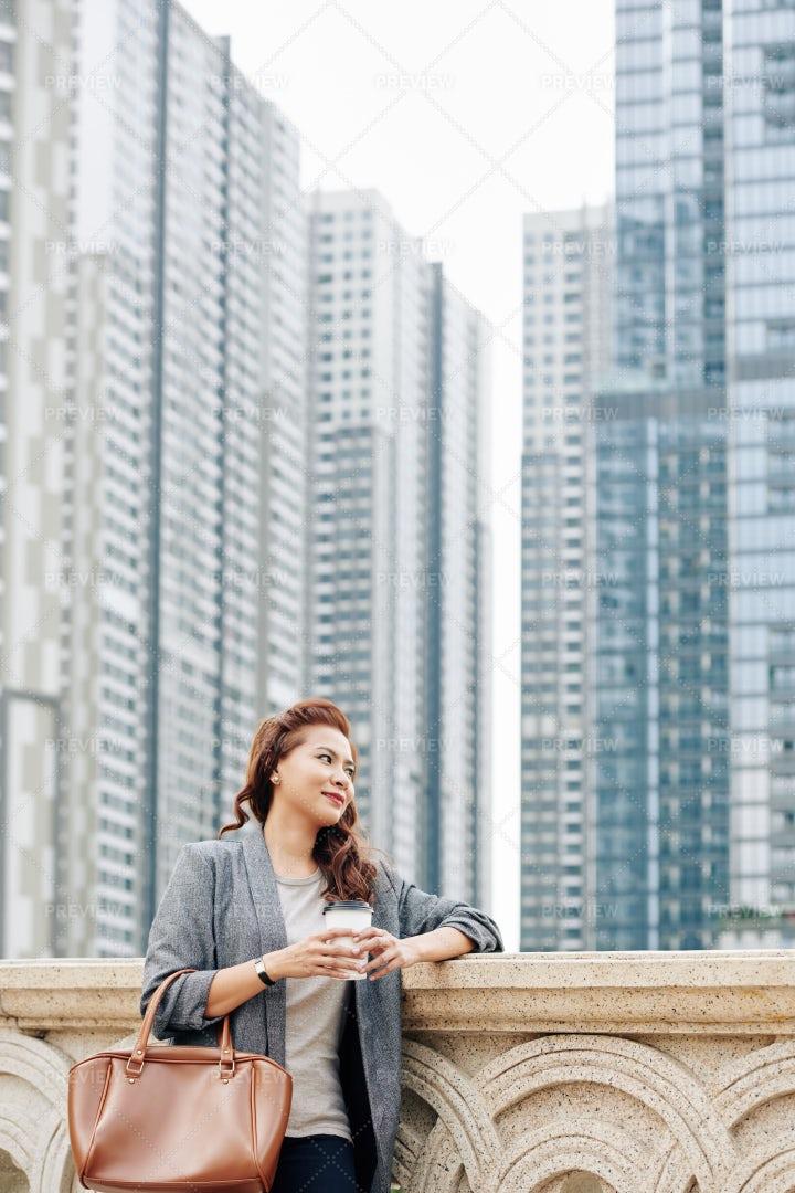 Businesswoman Drinking Coffee Outdoors: Stock Photos