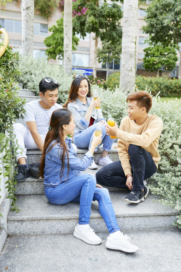 Young People Drinking Orange Juice: Stock Photos