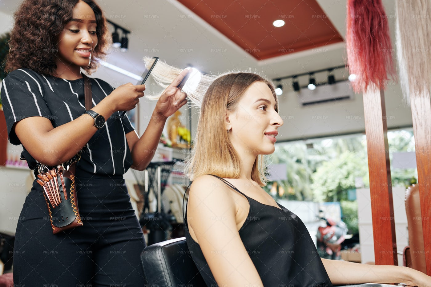 Young Woman Having Her Hair Done: Stock Photos