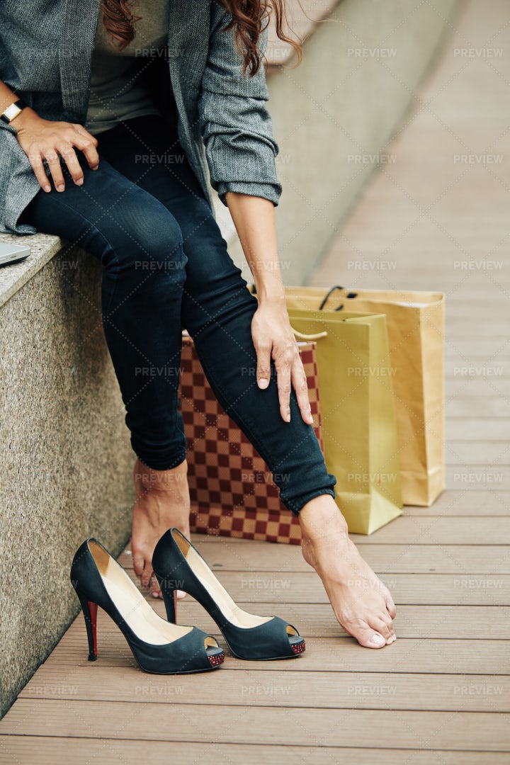 Woman Touching Her Tired Legs: Stock Photos