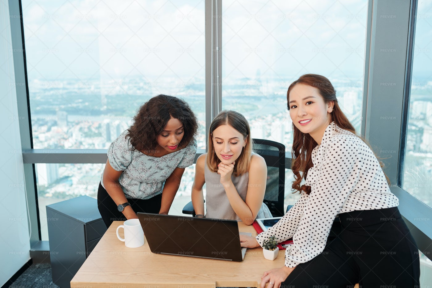 Multi-etnic Business Team Working On: Stock Photos