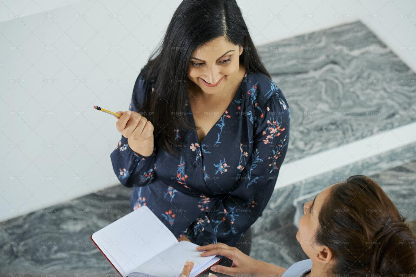 Cheerful Businesswoman Sharing Ideas: Stock Photos