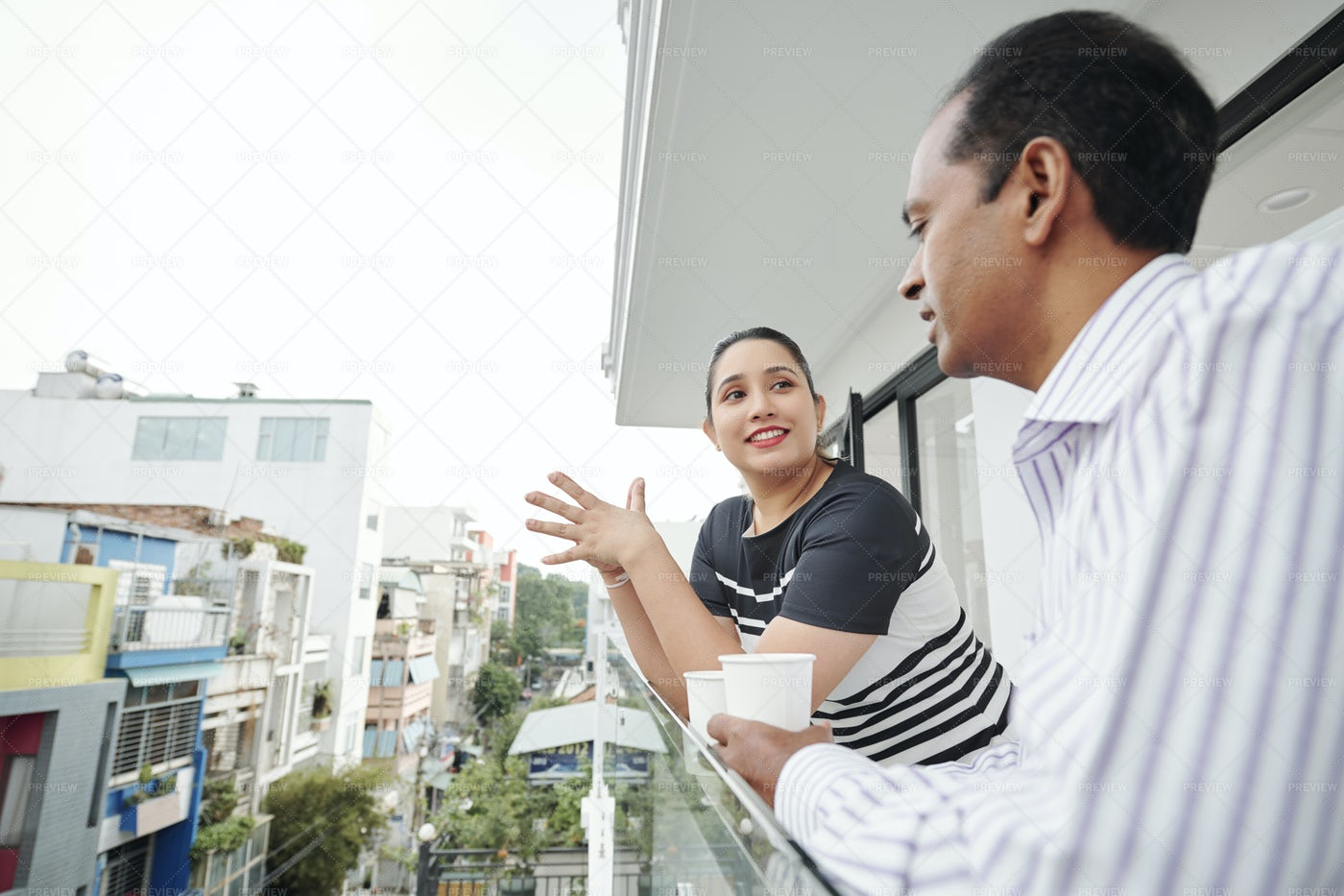 Business People Talking At Balcony: Stock Photos