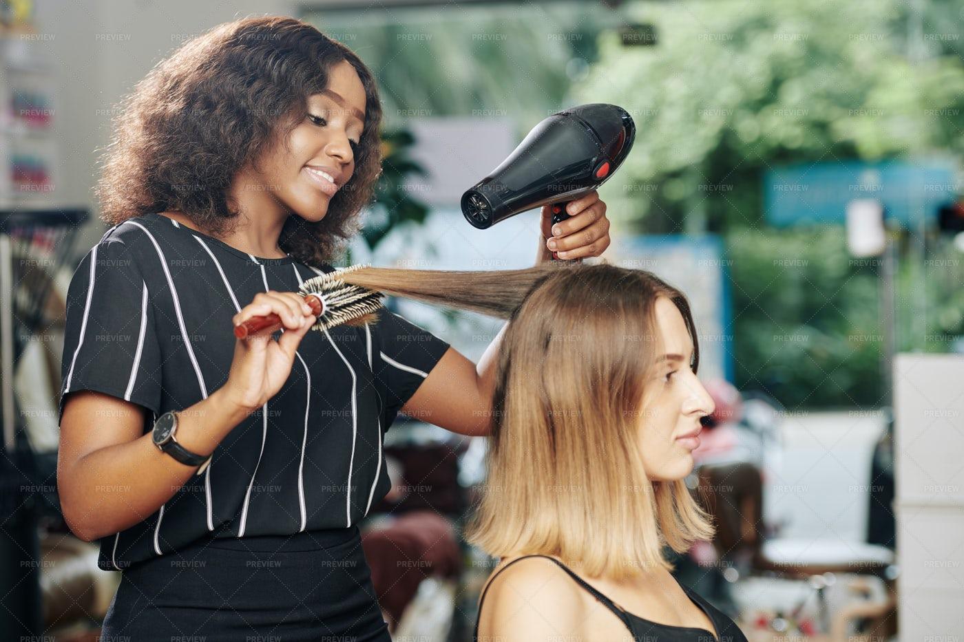 Hairdresser Working In Beauty Salon: Stock Photos