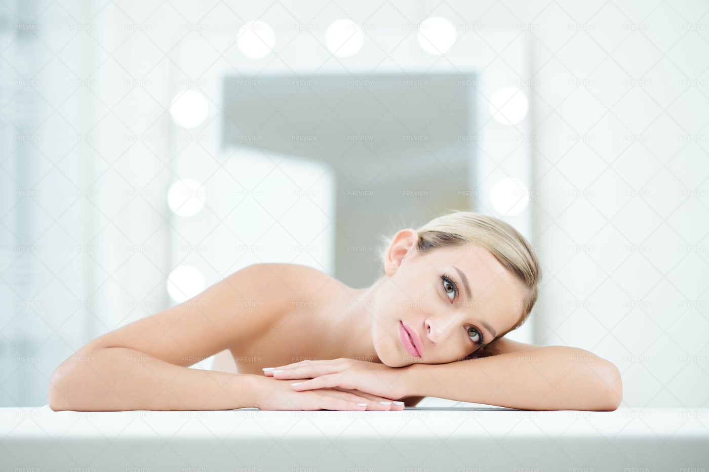 Pretty Woman Leaning On Her Hands: Stock Photos