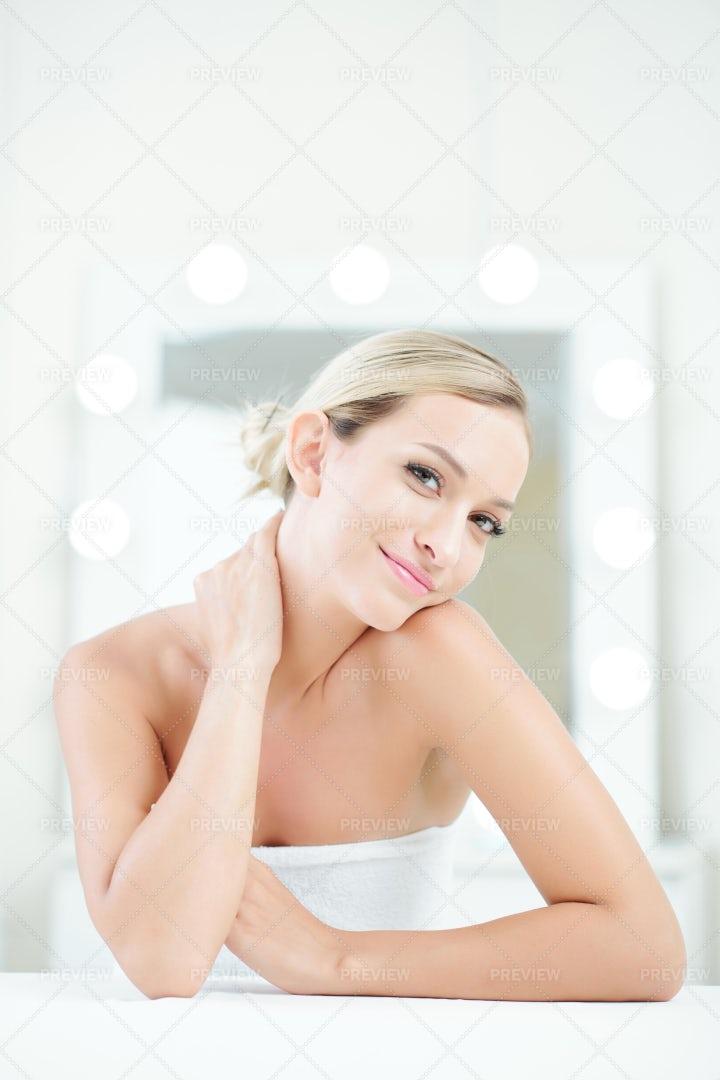 Smiling Woman Enjoying Her Soft Skin: Stock Photos