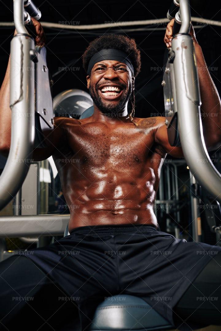 Muscular Man Training In Gym Machine: Stock Photos