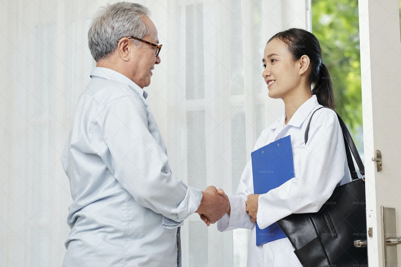 Patient And Doctor Shaking Hands: Stock Photos