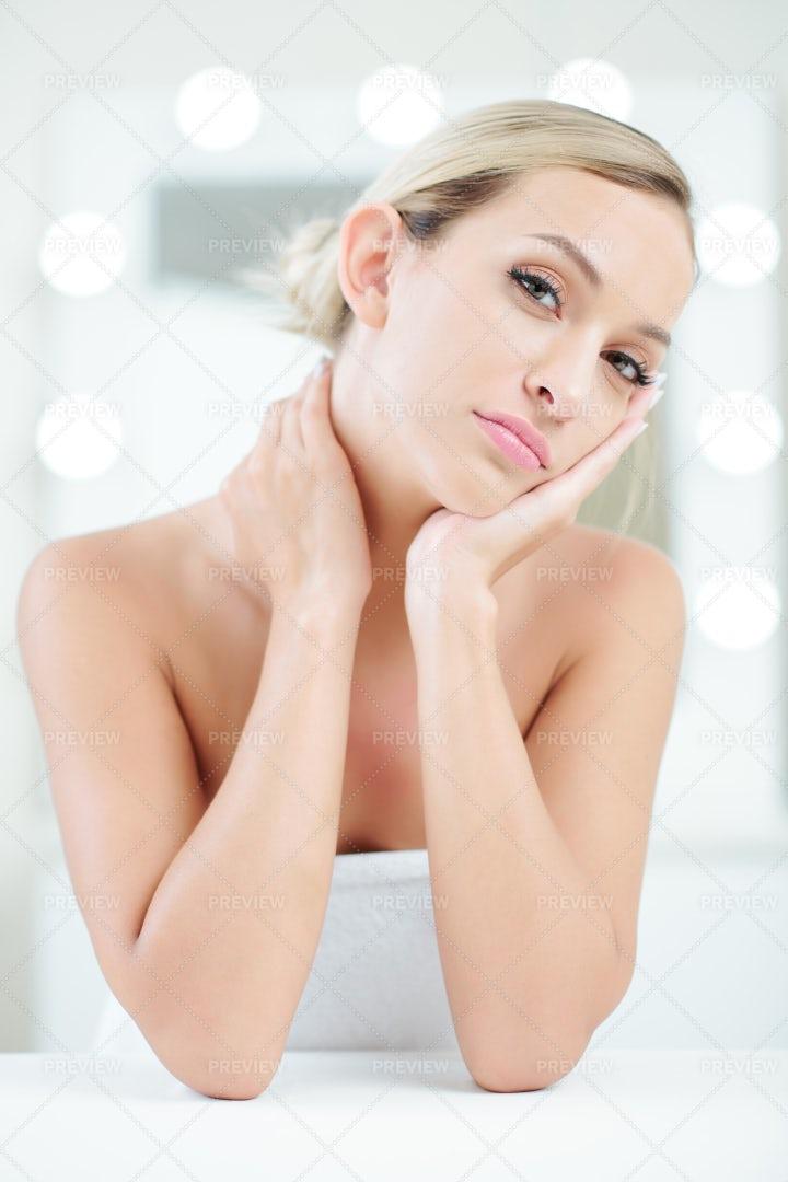 Pretty Woman Applying Face Cream: Stock Photos
