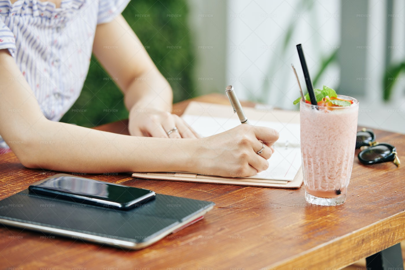 Female Student Writing In Notepad: Stock Photos