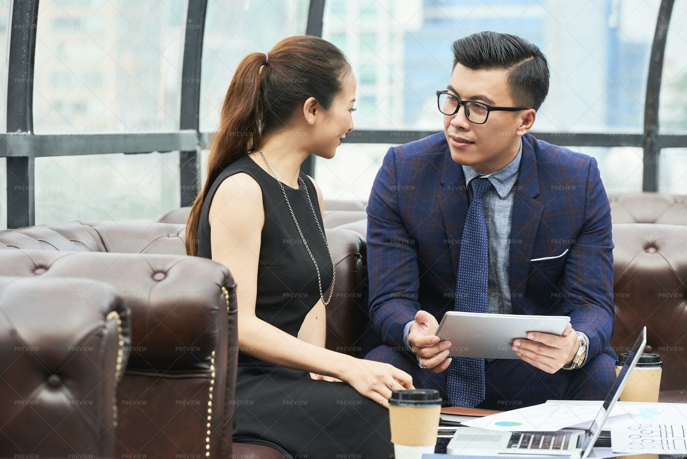 Business Partners Talking At Office: Stock Photos