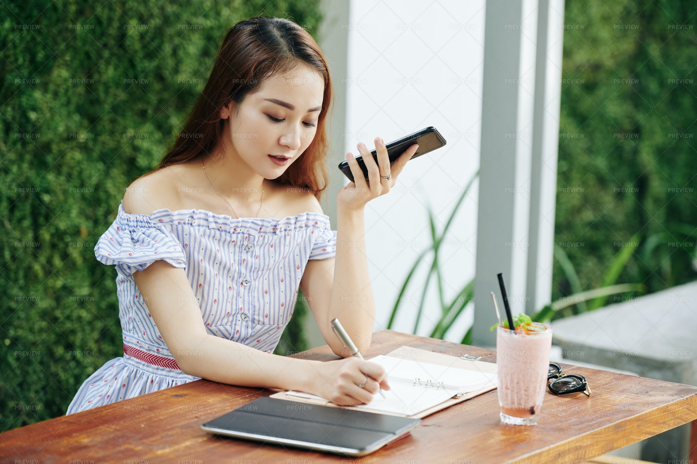 Woman Listening To Voice Message: Stock Photos
