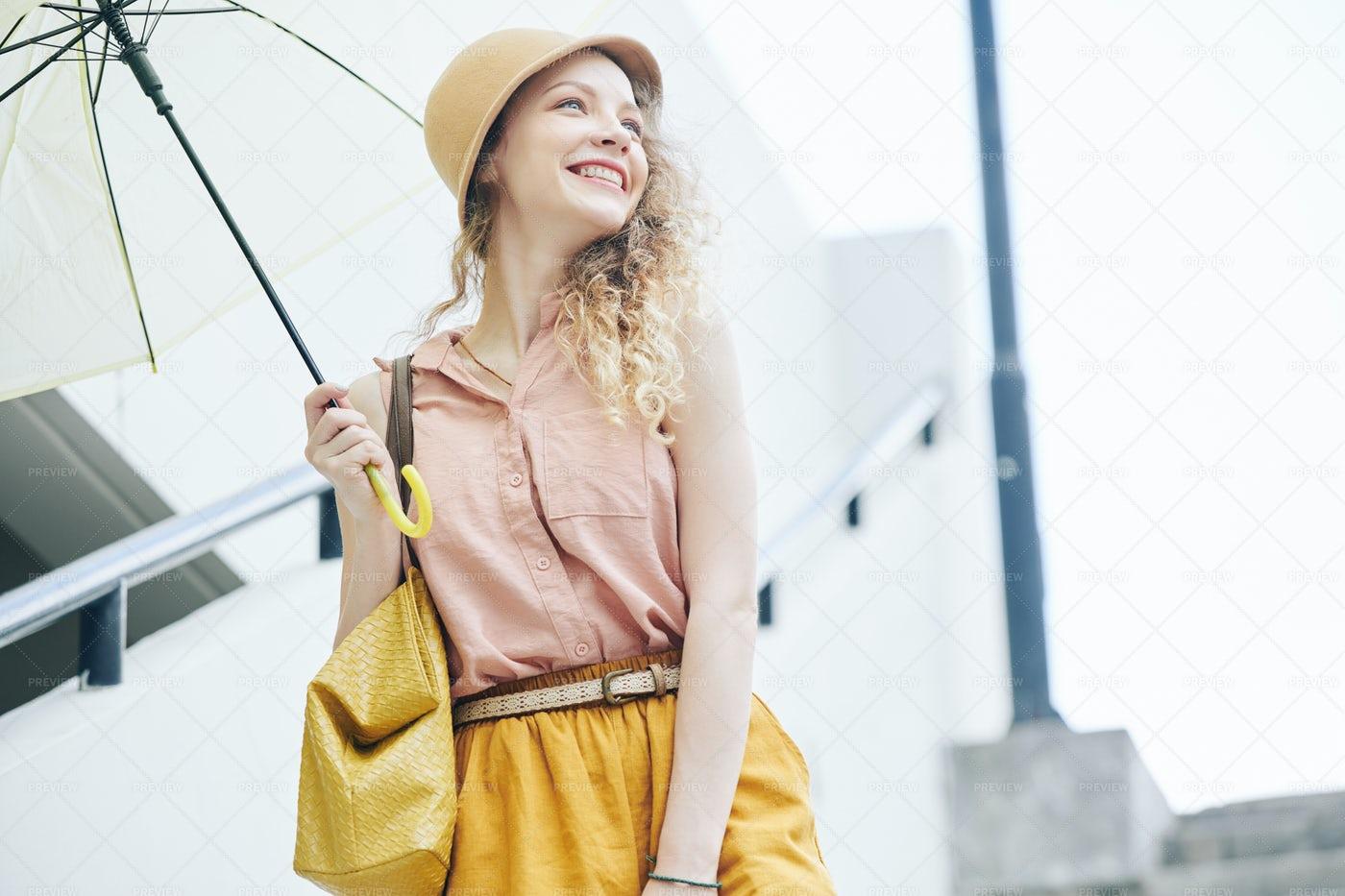Woman Enjoying Rainy Day: Stock Photos