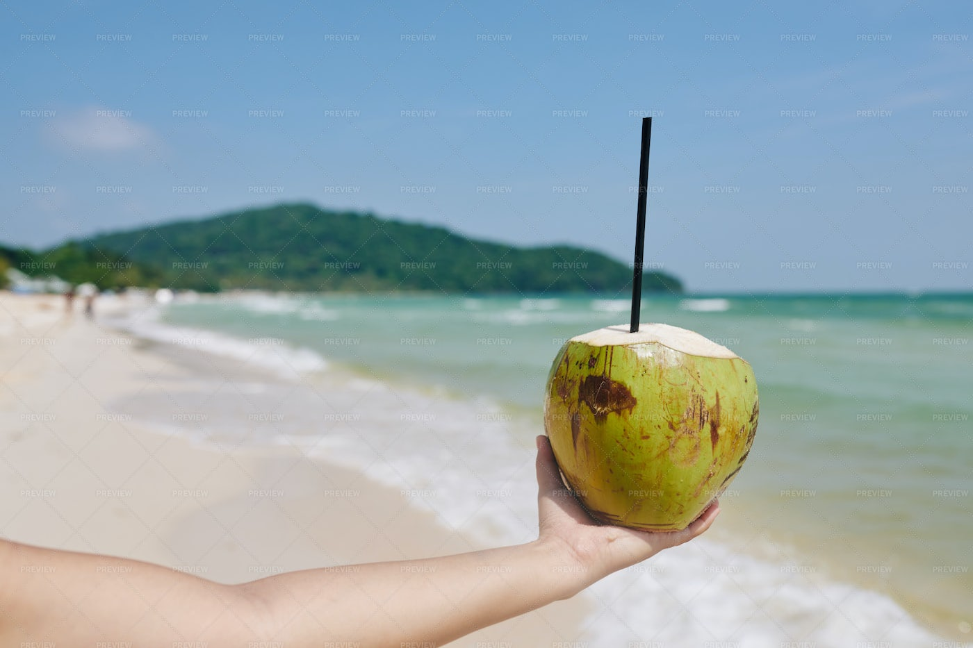Green Coconut With Drinking Straw: Stock Photos