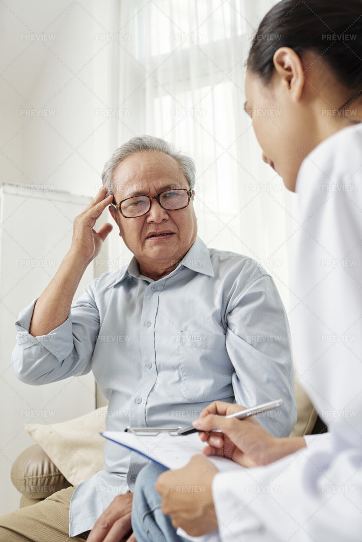 Doctor Writing A Treatment For Patient: Stock Photos