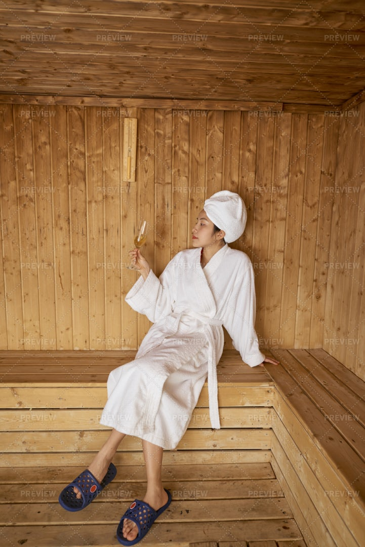 Woman With Champagne In Sauna: Stock Photos