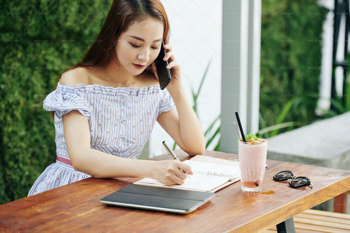 PRetty Young Woman Talking On Phone: Stock Photos