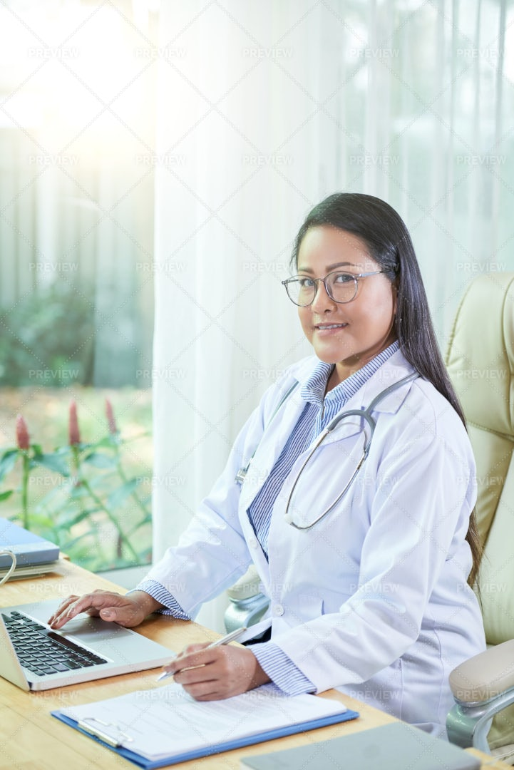 General Practitioner Workng In Office: Stock Photos