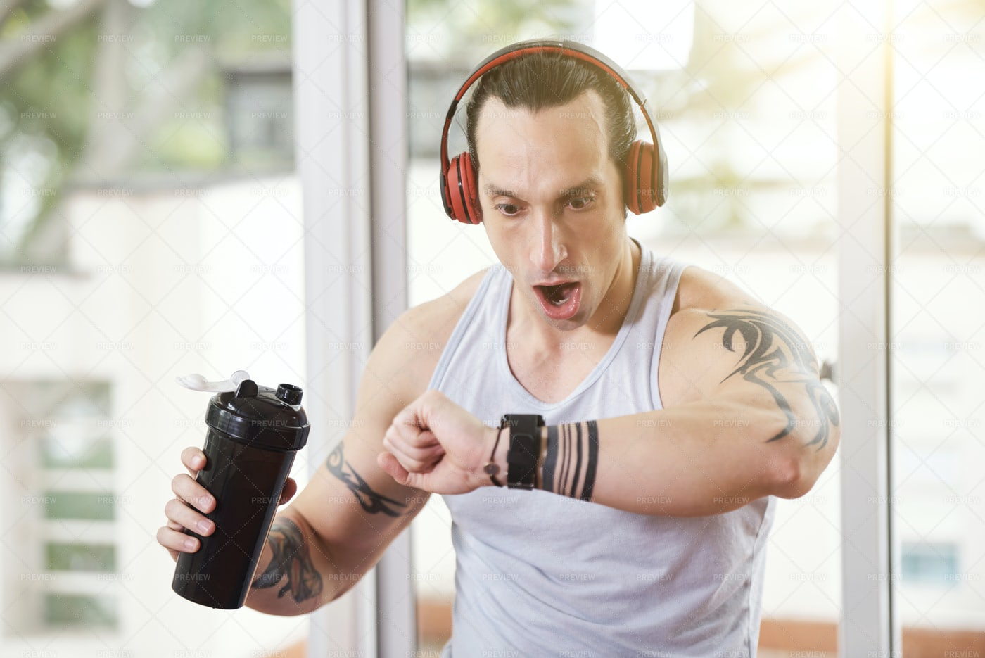 Shocked Sportsman Looking At Tracker: Stock Photos