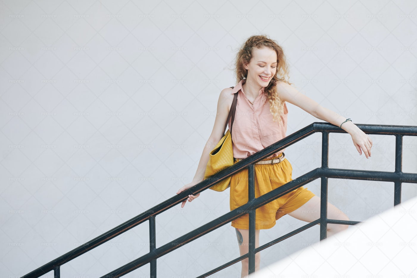 Happy Girl On Staircase: Stock Photos