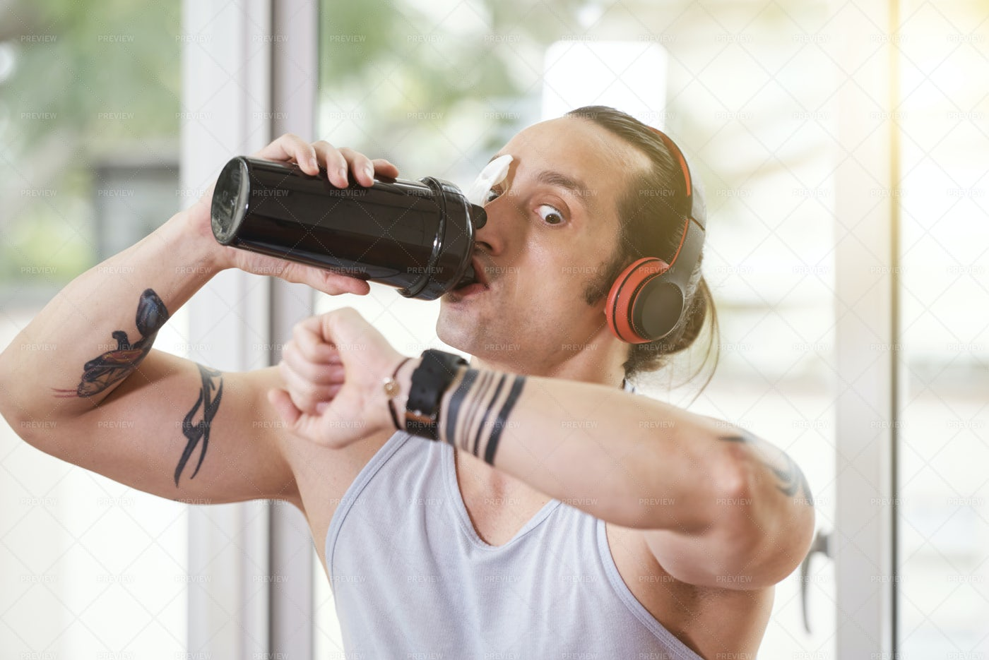 Sportsman Drinking Shake And Looking At: Stock Photos