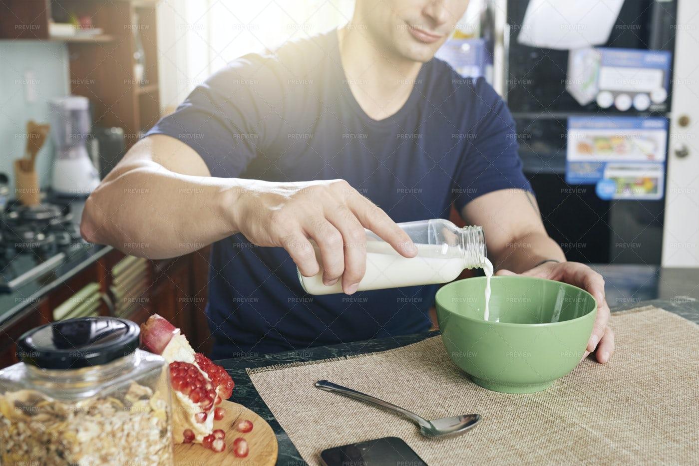 Man Preparing Cereal With Milk: Stock Photos